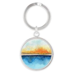 orange_rays_permeate_round_keychain